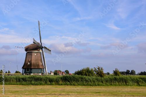 Fototapeta Photograph of a Classic Vintage Windmill in Holland obraz na płótnie