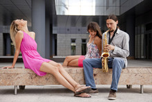Man Playing The Saxophone To W...