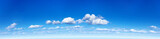 Fototapeta Na sufit - Panorama of the blue sky with clouds