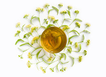 Herbal Tea - Cup Of Linden Tea Surrounded By Lindens On White Background. Healing Drink. Top View.