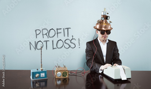 Fotografía  Profit, not loss ! text with vintage businessman at office