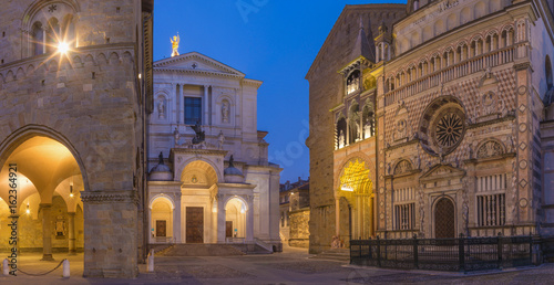 Poster Monument Bergamo - Colleoni chapel, Duomo and cathedral Santa Maria Maggiore in upper town at dusk.
