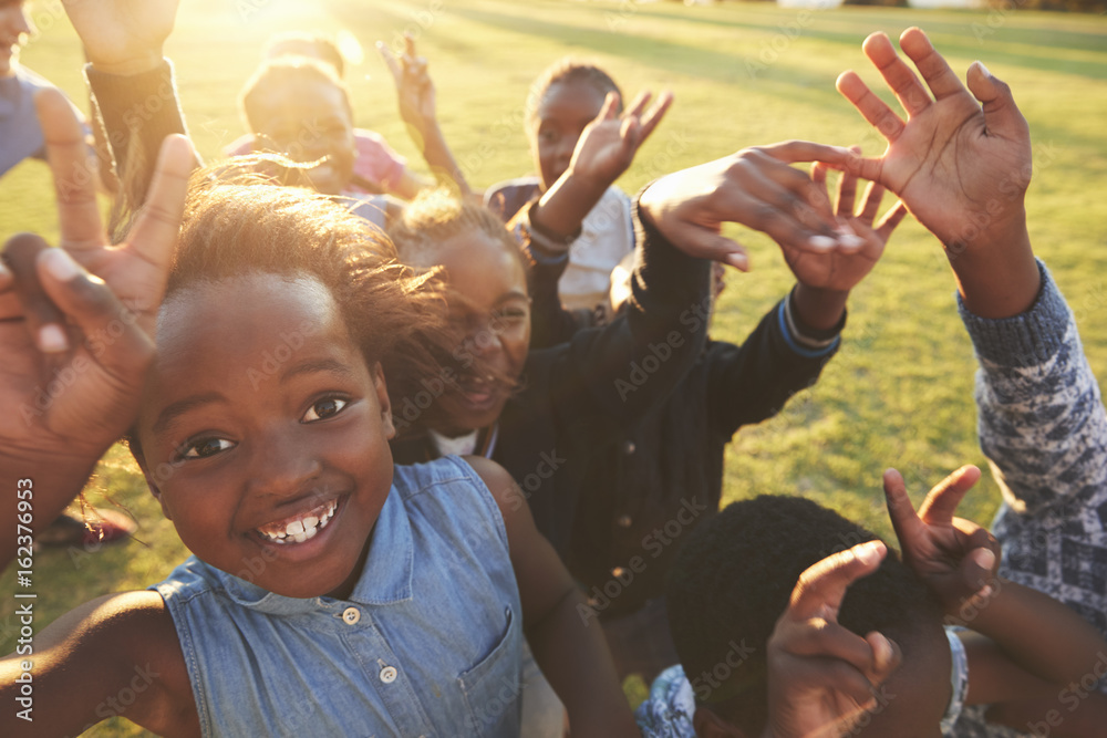 Fototapeta Elementary school kids outdoors, high angle, lens flare
