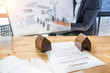Business man waiting signing agreement contract for buying house blurred background. Bank manager concept.