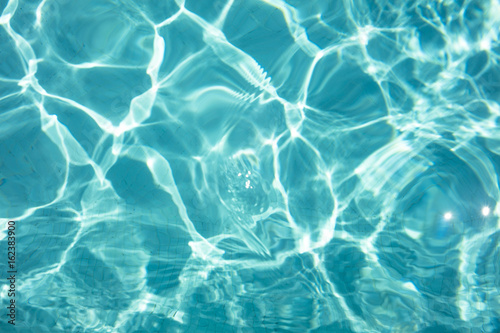Detal of swimming pool water and sun reflecting on the surface Wallpaper Mural