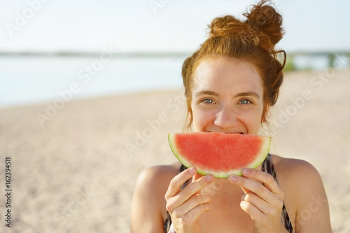Fun young woman with a watermelon smile