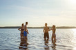Group of young friends cooling off in the sea