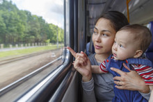Mother And Her Son Have A Journey By Train