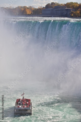 Garden Poster Water Motor sports Beautiful background with amazing Niagara waterfall and a ship in the mist