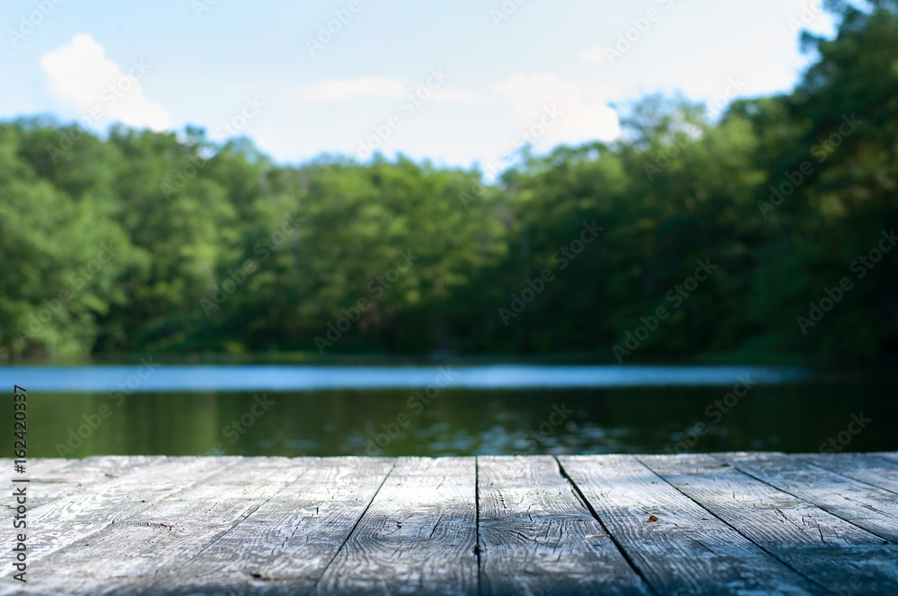 Beautiful forest and lake with a wooden board.