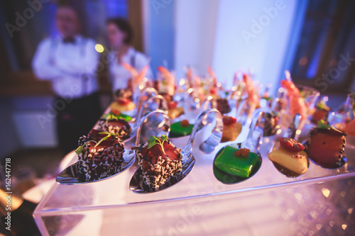 Foto op Aluminium Voorgerecht Decorated catering banquet table with different food appetizers assortment on a party