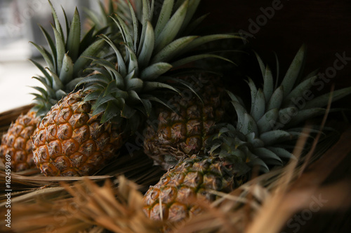 Fototapety, obrazy: Pineapple in wood box