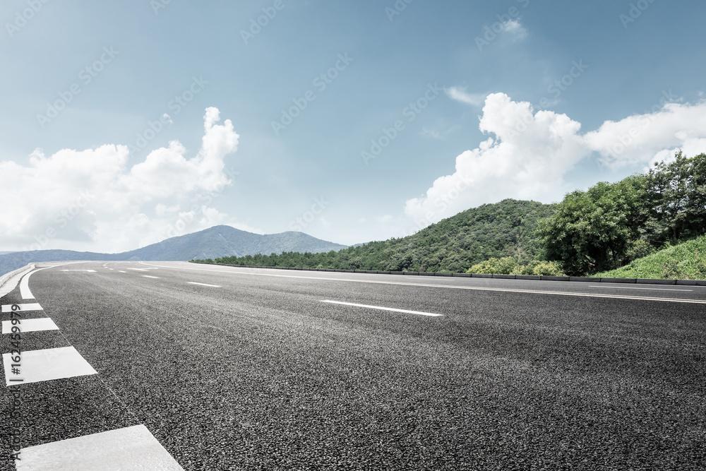 Fototapeta asphalt road and mountain background