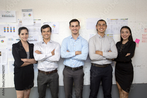 Fototapety, obrazy: Businesspeople standing together with attractive smiling at working place, business teamwork concept, 5 person.