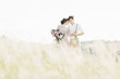 canvas print picture - wedding couple on  nature.  bride and groom hugging at  wedding.
