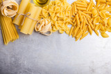 Italian cuisine cooking ingredients, variety of pasta shapes - 162475151