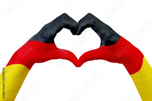 Plakat Ręce flaga Niemiec, kształt serca. Pojęcie kraju symbol, odizolowywający na bielu.