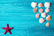 Seashells on blue wooden background