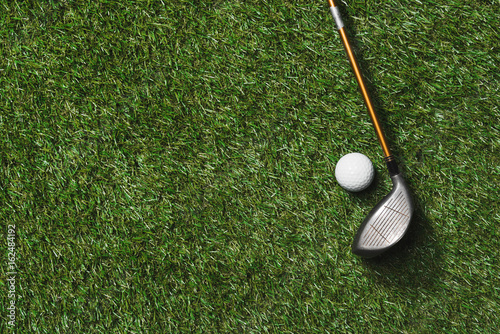 top view of golf club and ball on grass field