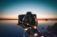 Holding A Camera , Sunset,