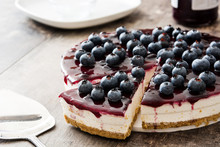 Blueberry Cheesecake On Wooden Table