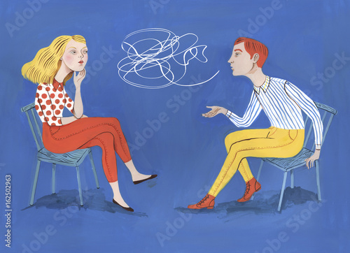 Woman and man sitting on chairs talking