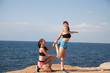 fitness instructor teaches a woman to play sports