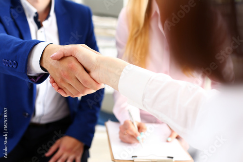 Fototapety, obrazy: Man in suit shake hand as hello in office closeup