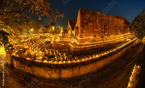 Buddhism light waving rite walk with lighted candles in hand around on Vesak day Wallpaper Mural