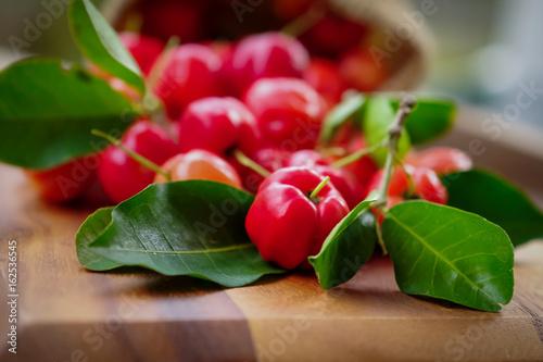 Photo Acerola fruit close up on background.