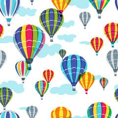 Vector seamless pattern with colorful hot air balloons in the sky. Hand drawn doodle illustration. Summer design for fabric and fashion textile print.