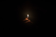 Hand Holding Burning Candle In...
