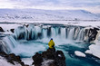 canvas print picture - Adventurous man at Godafoss, Iceland in winter