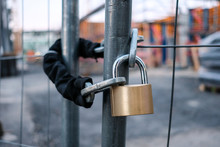 Chain And Padlock On Gate At Construction Site
