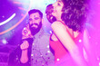 canvas print picture - Happy friends having fun in night club with canon ball throwing confetti - Young people enjoying weekend nightlife with original laser lights color - Soft focus on bearded white man - Warm filter