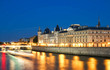 The Conciergerie castle at night, Paris, France.