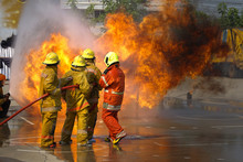 Fireman. Firefighters Fighting Fire During Training.
