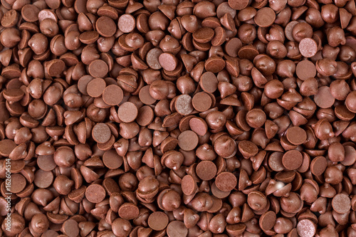 Texture of small chunks of sweetened chocolate chips background
