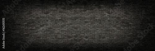 Fotobehang Baksteen muur Black brick wall panoramic background.