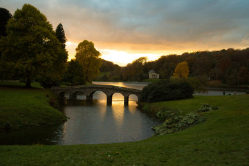 Fototapeta na wymiar Bridge over lake during sunset