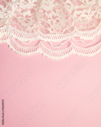 Valokuva  White Lace on Pink Background