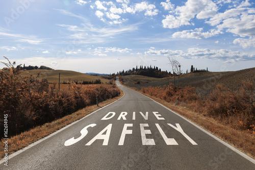 Fotografie, Obraz  Concept drive safely message on the sunny summer asphalt country road
