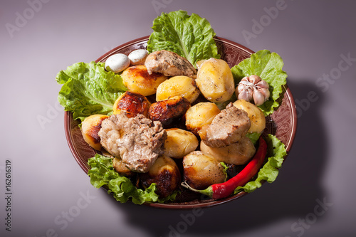 Fotografie, Obraz  Beautifully decorated dish of potatoes, meat and vegetables