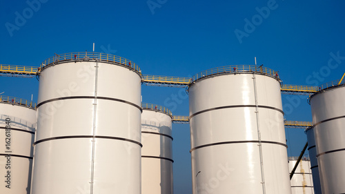 Rows of oil storage tanks - Buy this stock photo and explore