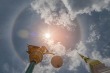 Abstract Soft Blurred And Soft Focus Sun Halo With The Sanctuary, Temple, Beautiful Sky Cloud By The Beam, Light And Lens Flare Effect Tone.The Public Properties At Wat Phra That Tha Uthen, Thailand.