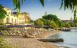 Beautiful beach near the sea with chairs and umbrellas, in Nidriana Lefkada, Greece