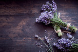 Fototapeta Lavender - Bunches of fresh aromatic lavender on rustic wood