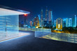 Kuala Lumpur skyline at night with balcony view .