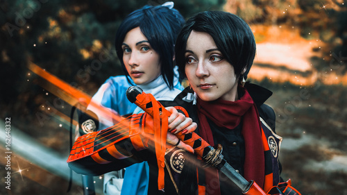 Photo  Two Samurai (shoulder to shoulder) are preparing for battle