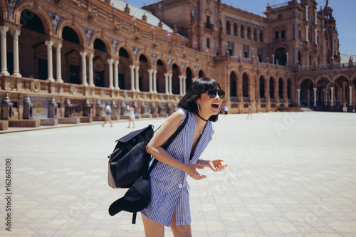 Female tourist posing happily